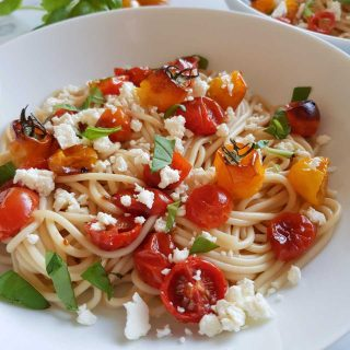 Pasta with tomatoes, feta and basil.
