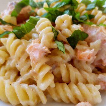Salmon and creme fraiche pasta with basil.