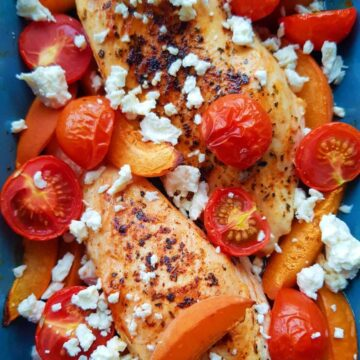 chicken, tomatoes, feta and apricots in a casserole dish.