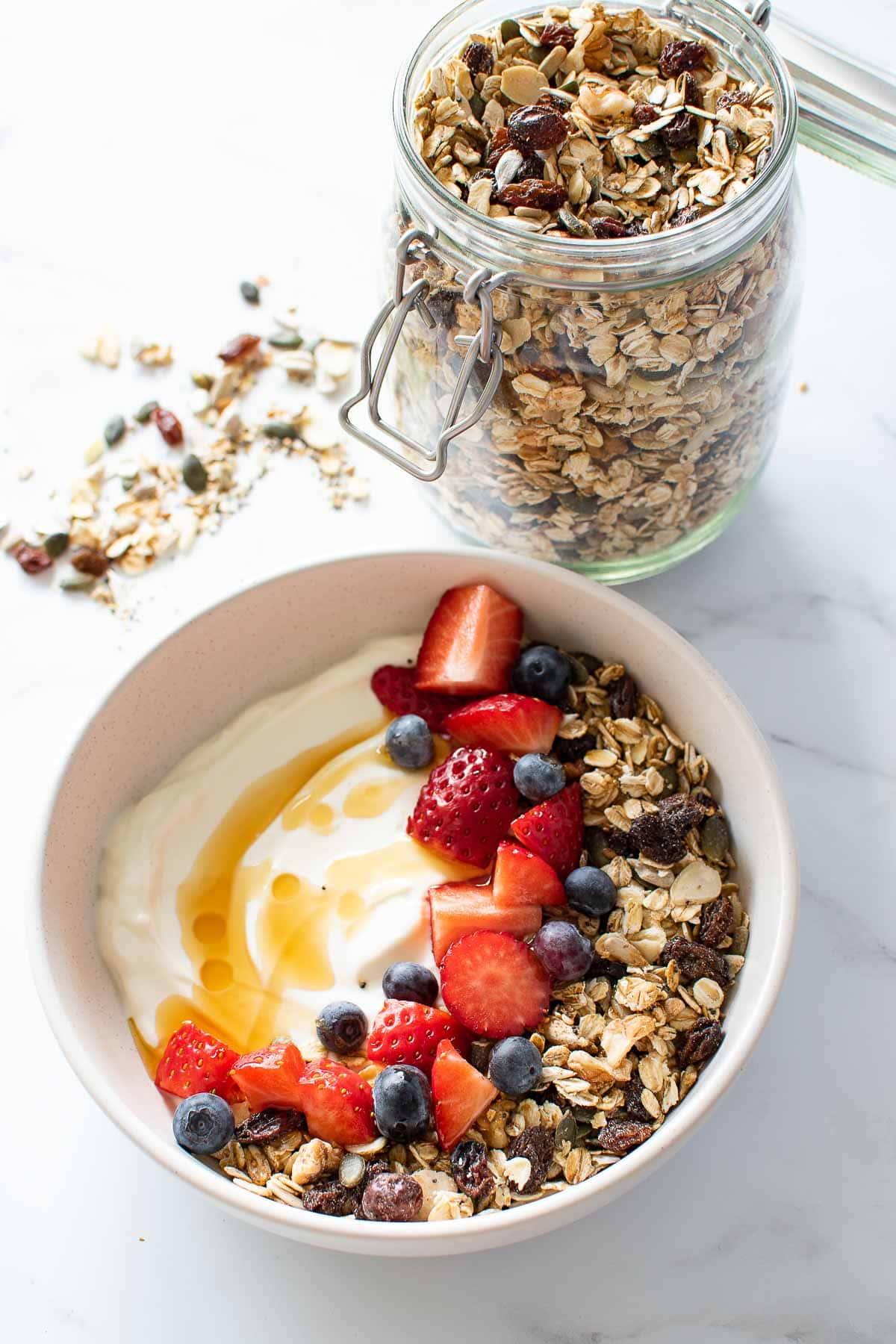 A yogurt bowl with muesli and berries.