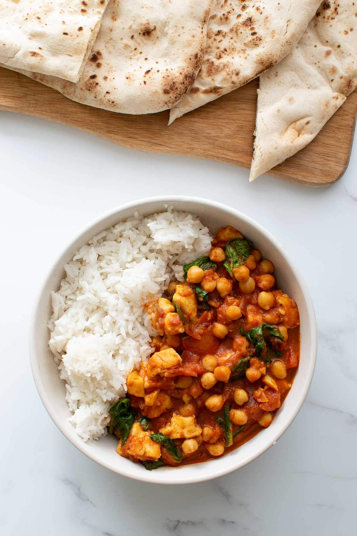 Chickpea, halloumi and spinach curry with rice.