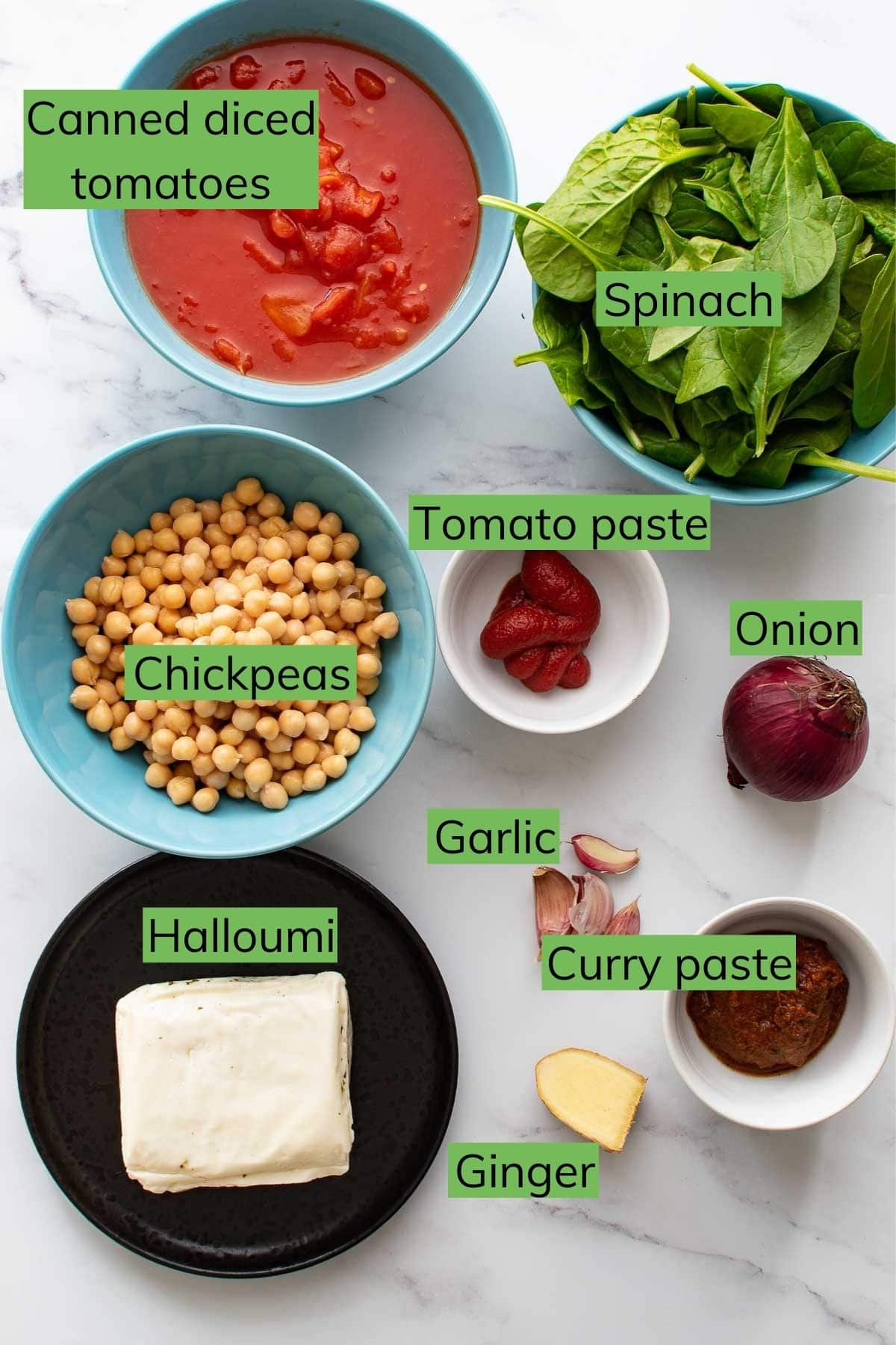 The ingredients needed to make Chickpea and Halloumi Curry laid out on a table.