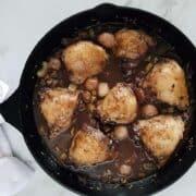 Coq au vin in a cast iron pan.