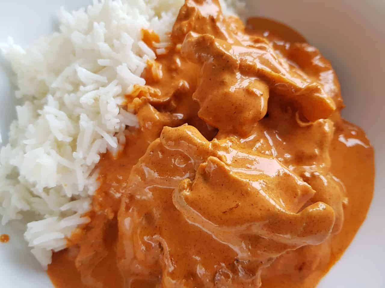 Paprika chicken on a plate with rice.