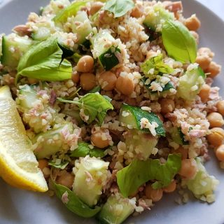 Tuna bulgur salad with chickpeas and cucumber on a plate ready to serve.