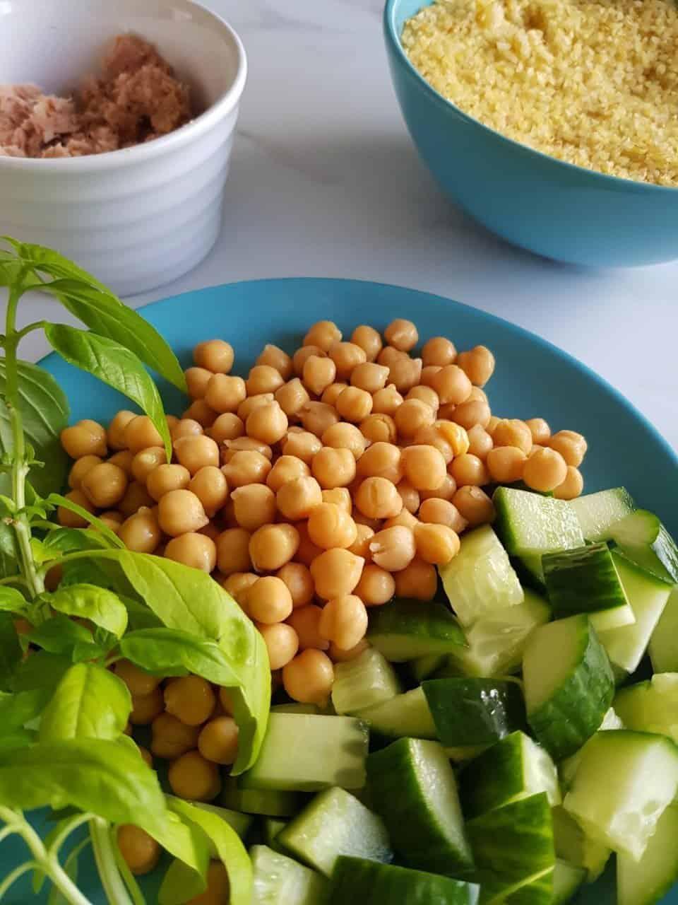 All ingredients needed to make a tuna bulgur salad.