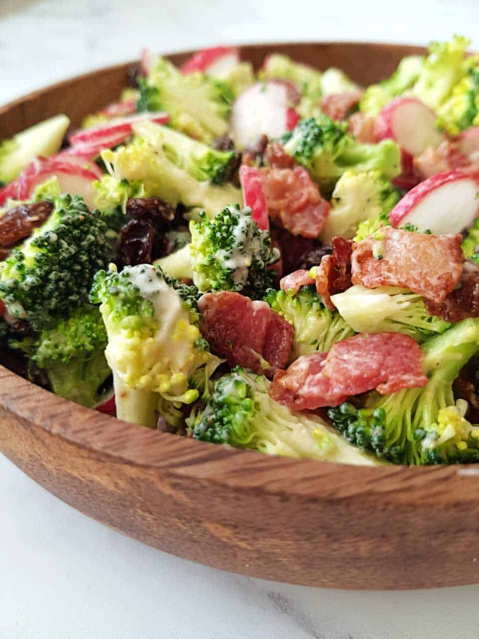 Broccoli salad in a wooden bowl.