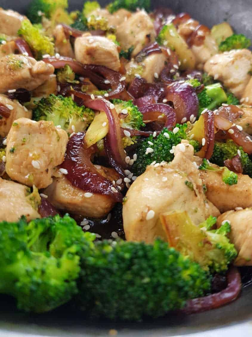 Chicken and broccoli stir fry in a pan.