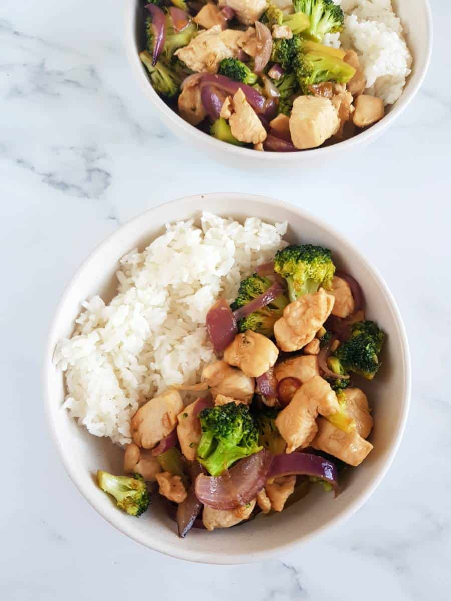 Chicken broccoli stir fry in bowls with rice.