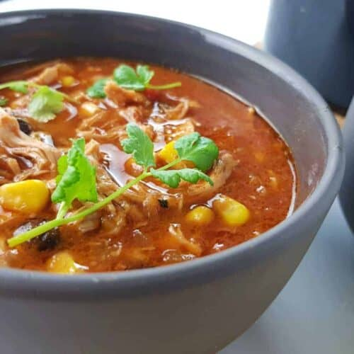 Chicken taco soup in gray bowls.