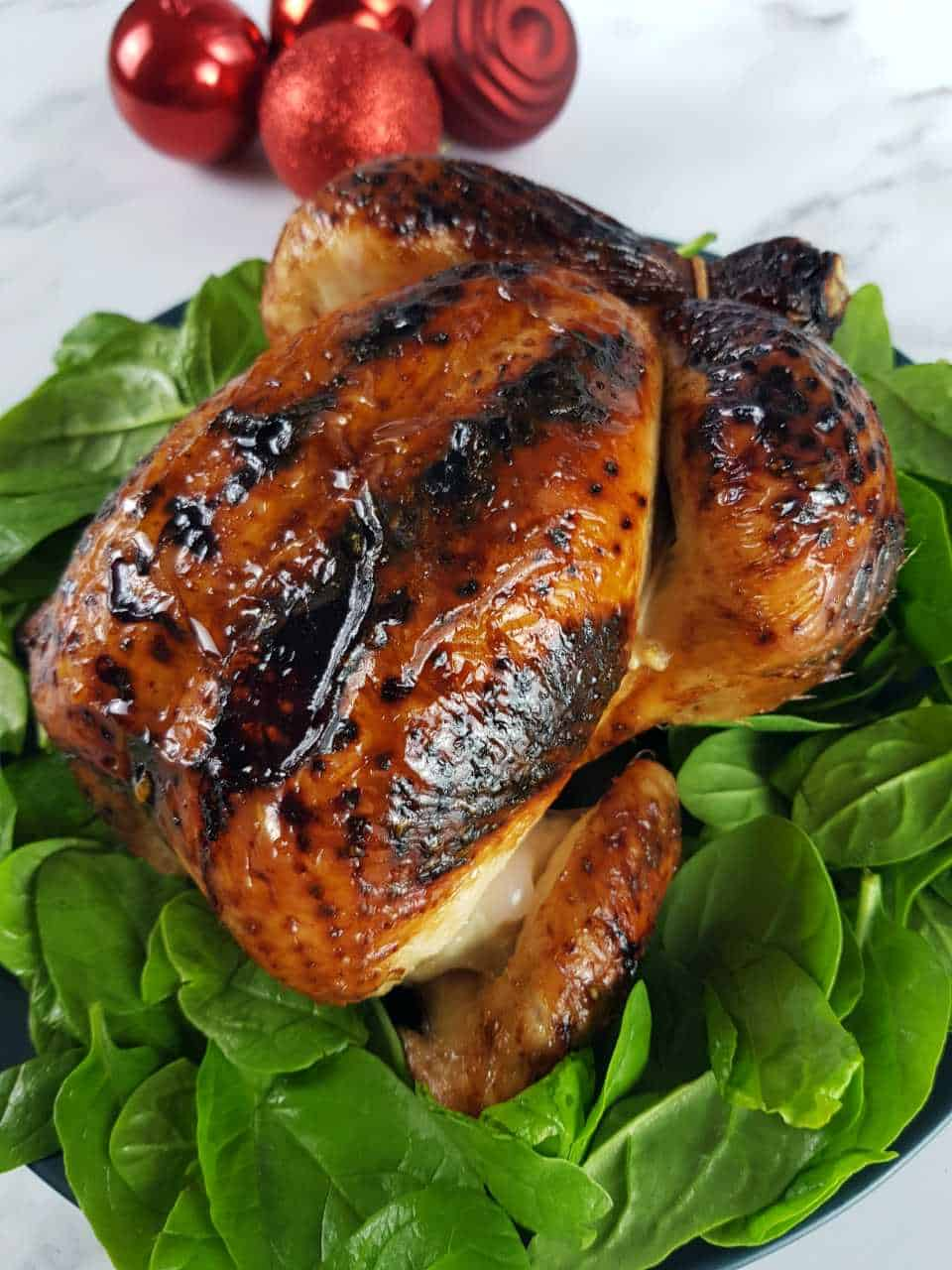 Roast chicken with honey on a bed of spinach.