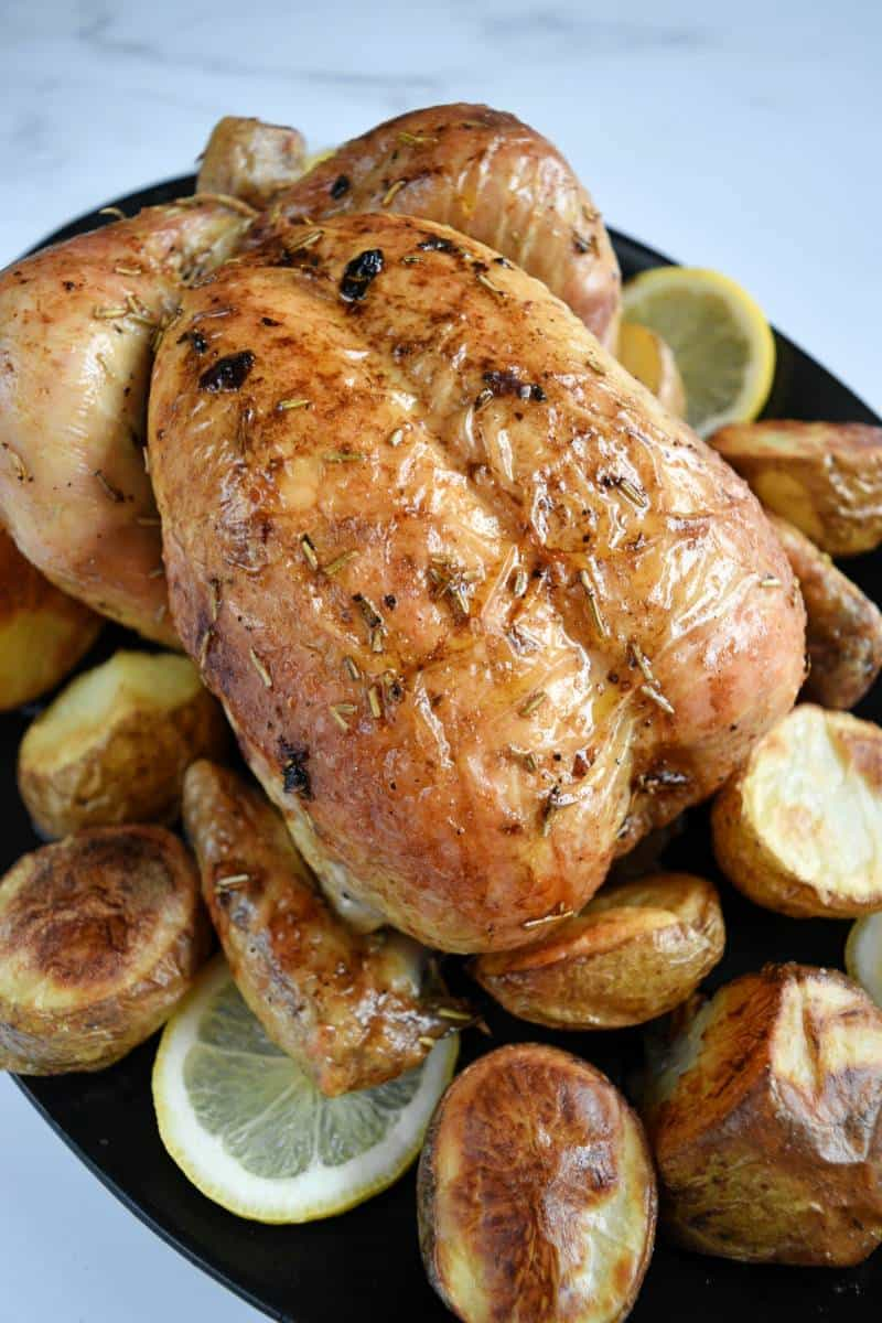 Roast chicken with lemon and rosemary with potatoes.