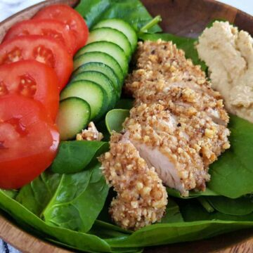 walnut coated chicken with salad.