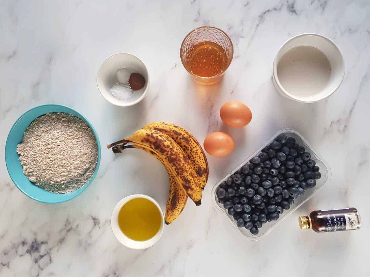 Banana bread ingredients on a marble table.