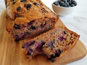 Blueberry & banana bread on a wooden chopping board.