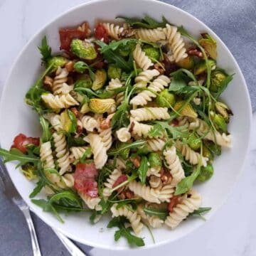 pasta salad with arugula, brussels sprouts and bacon.