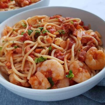 spaghetti, prawns and chorizo in a bowl.