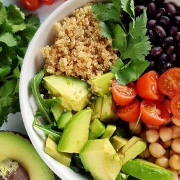 a bowl of mixed quinoa avocado salad.