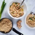 Spring onion and ginger chicken in a bowl with a pot of rice on the side.