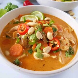 chicken noodle soup with thai flavors in a bowl.