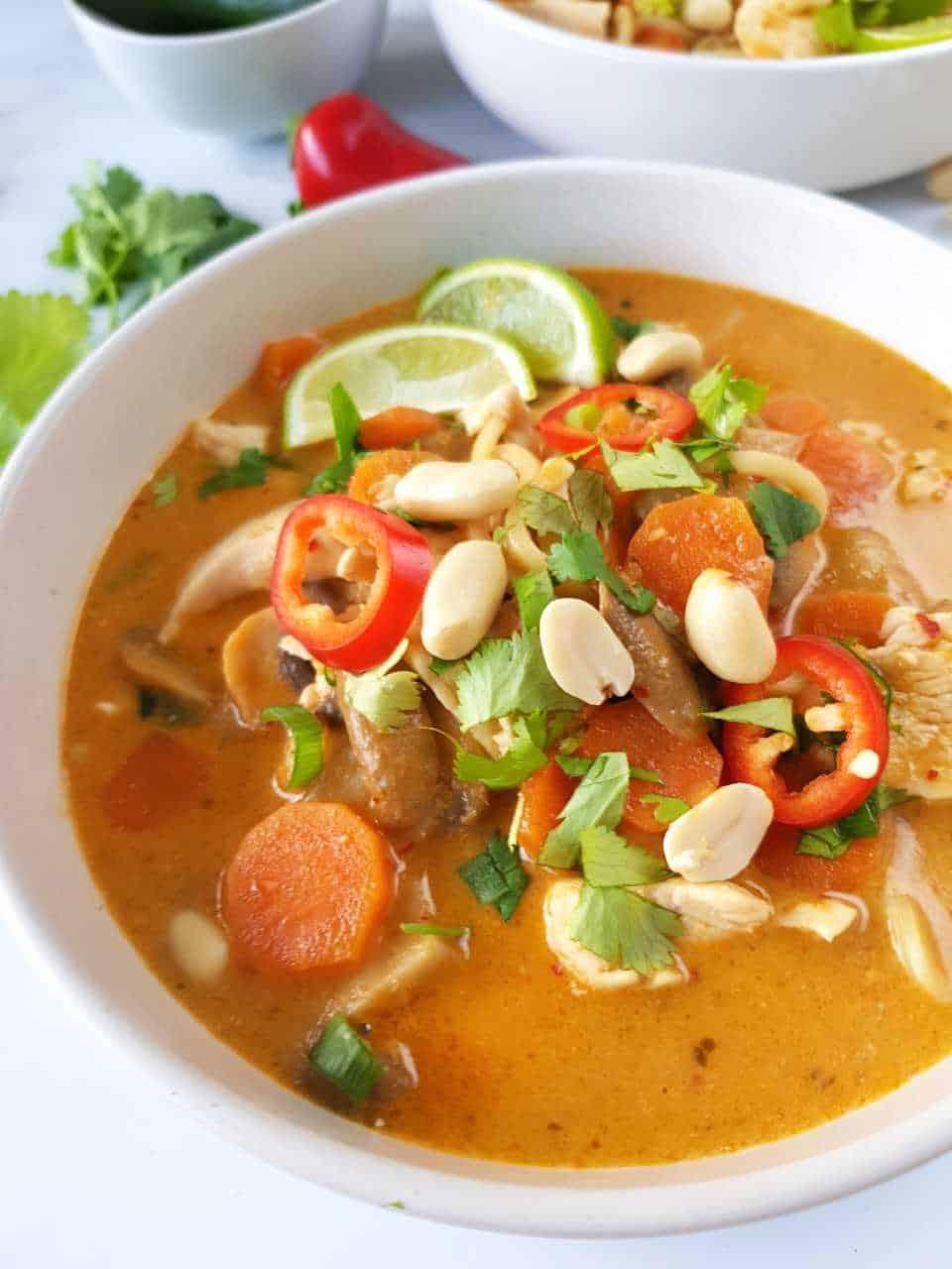 Thai coconut ramen in a white bowl.
