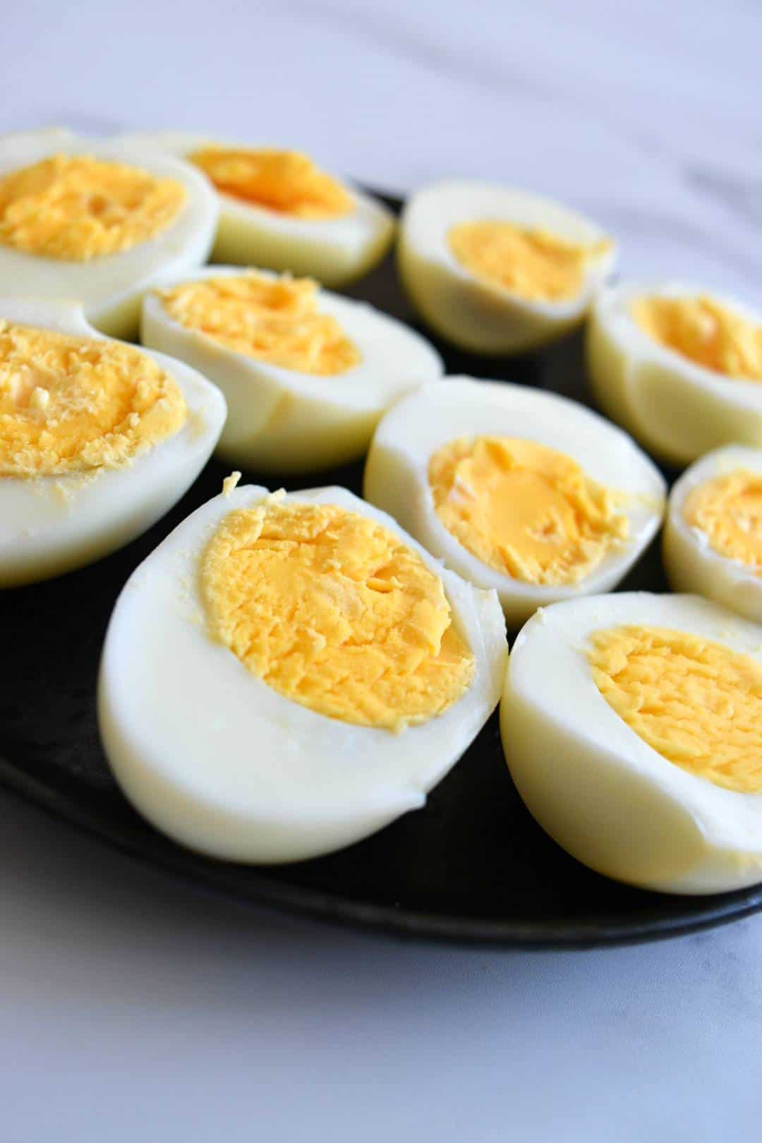 Hard boiled eggs cut in half on a plate.