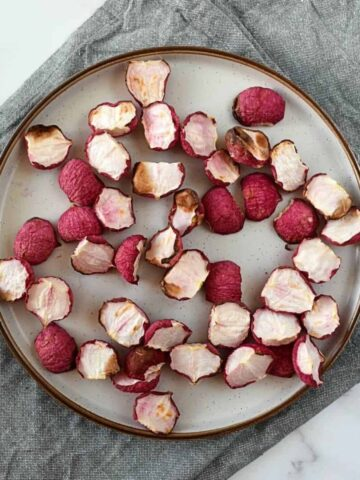 Roasted radishes on a plate.