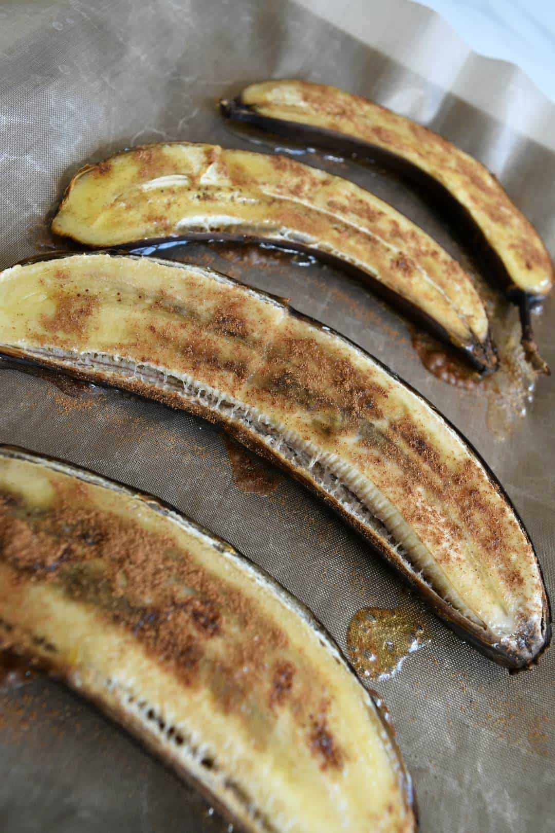 Baked bananas on a baking tray.