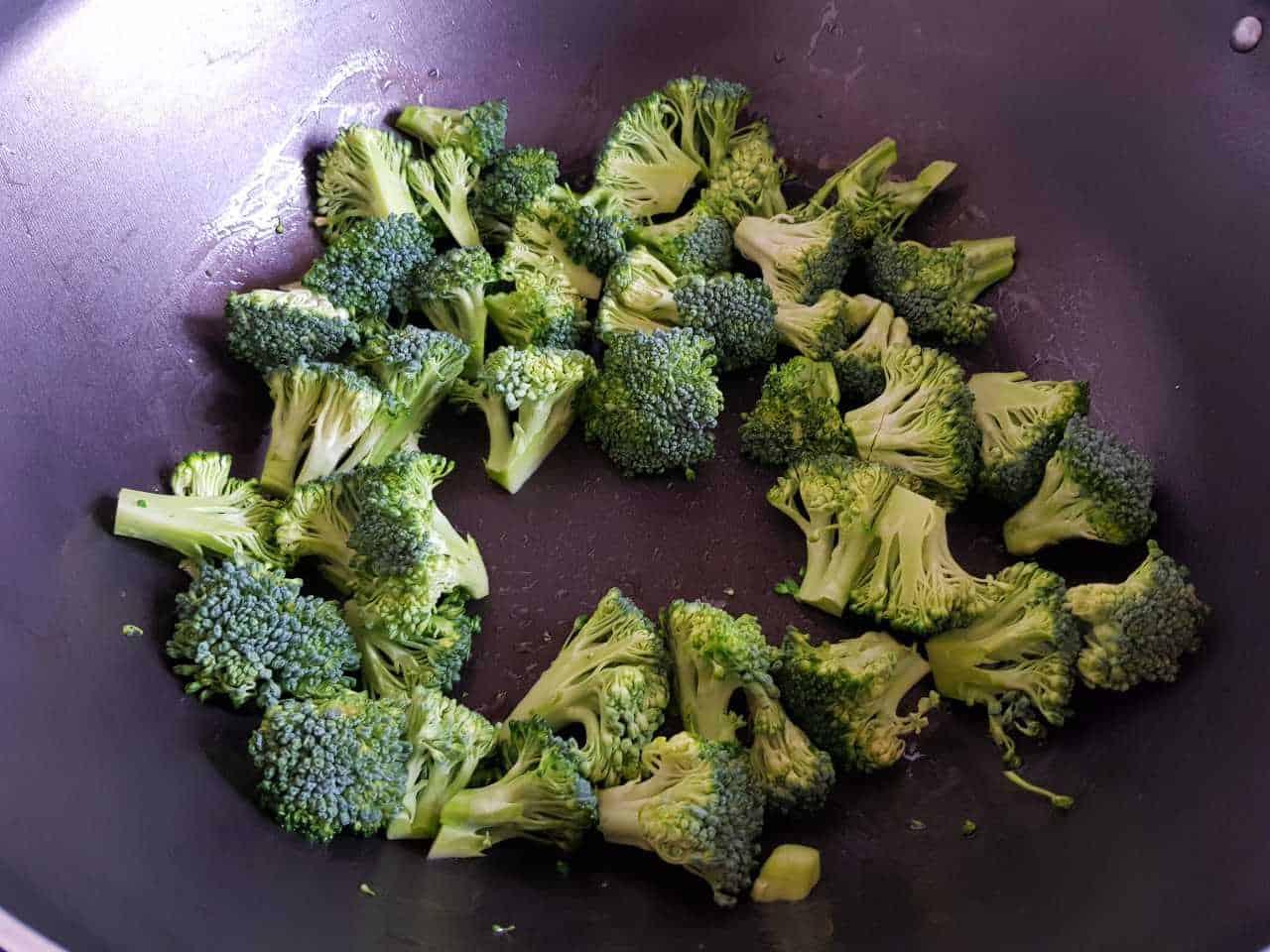 Broccoli in a wok.