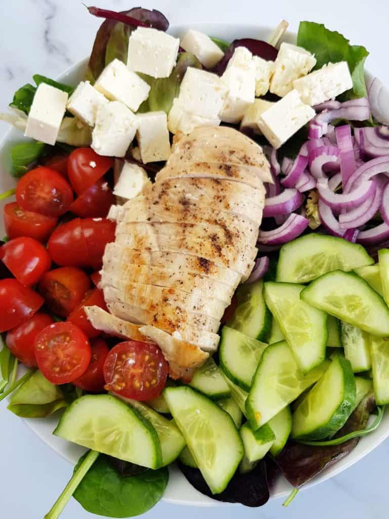 Greek chicken salad with feta, tomatoes, red onion and cucumbers.