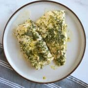 Lemon butter cod on a plate.