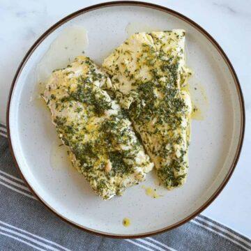 Lemon butter cod on a plate.