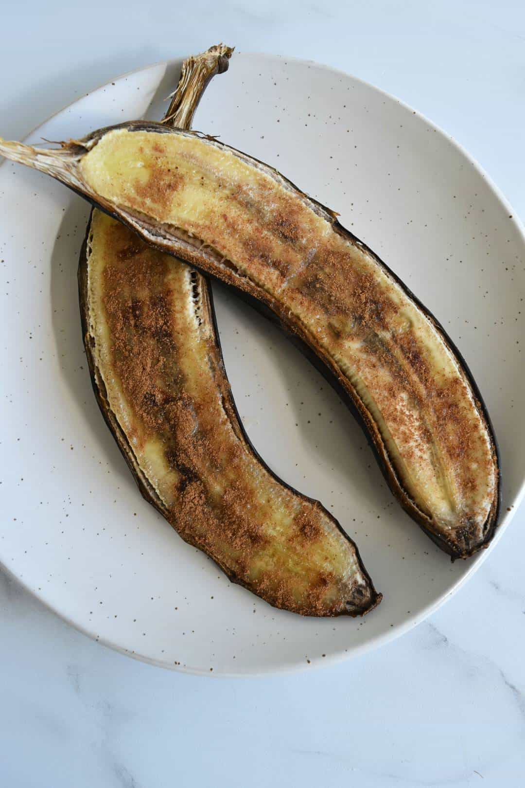 Oven baked bananas on a plate.