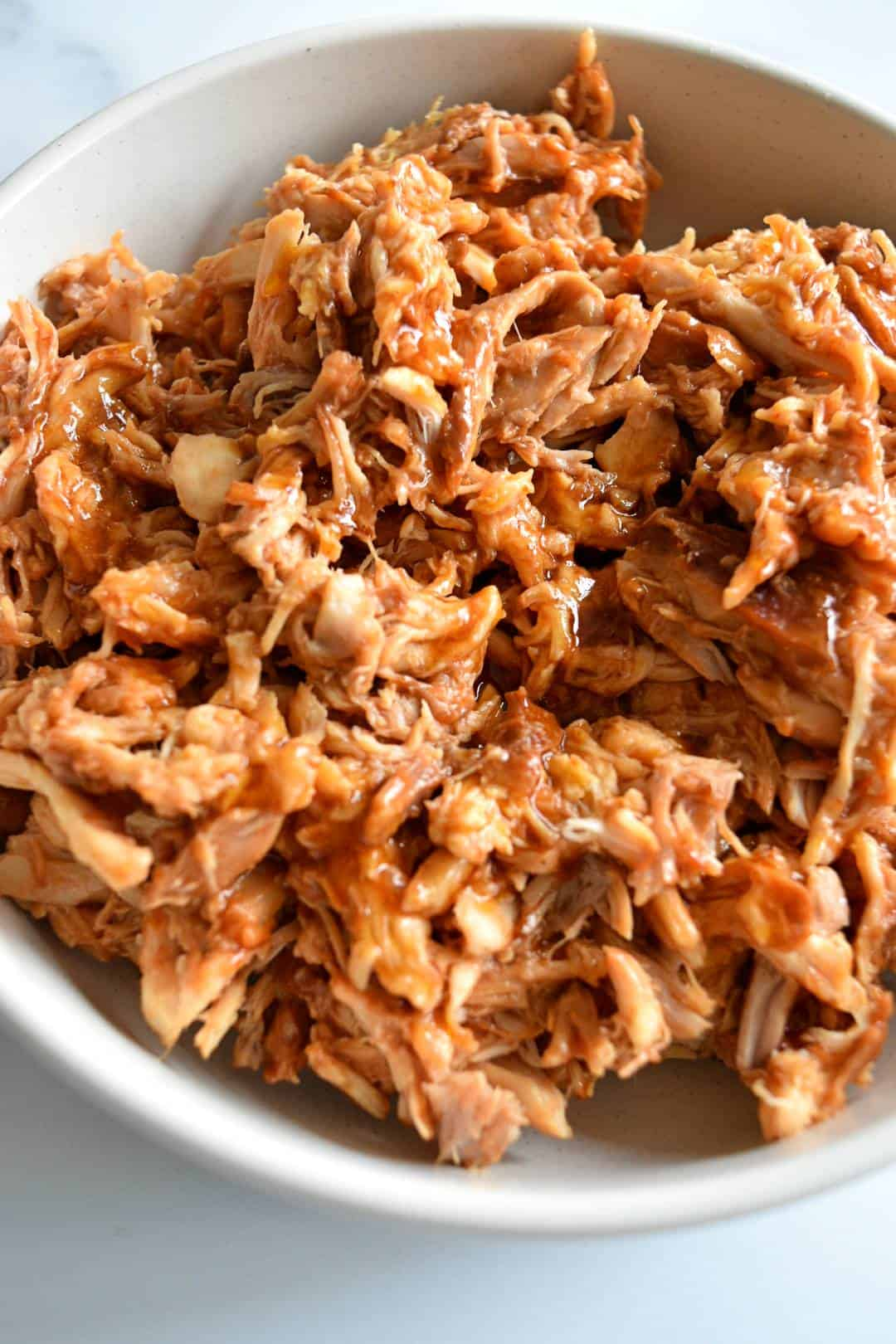 Pulled BBQ chicken in a bowl.