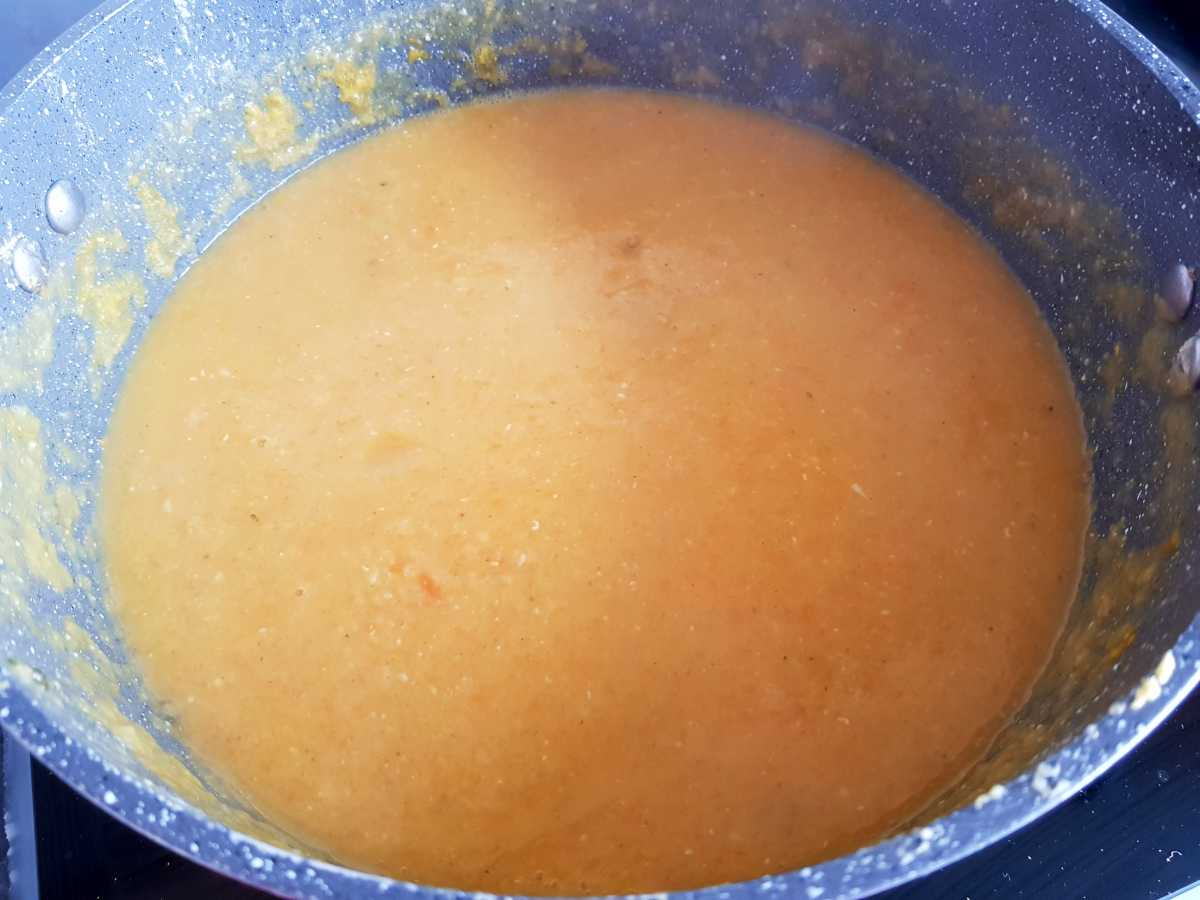 Smooth lentil soup in a pot.