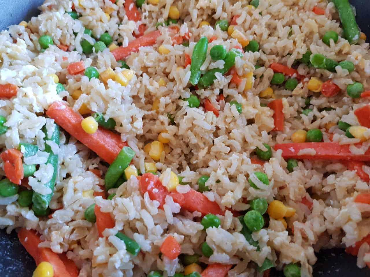 Making egg fried rice.