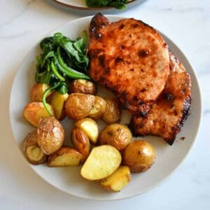 Air fryer pork chops with potatoes.