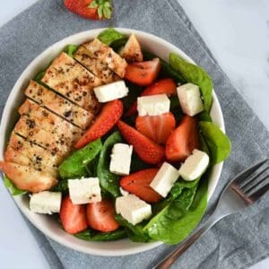 Chicken and strawberry salad with feta and spinach.