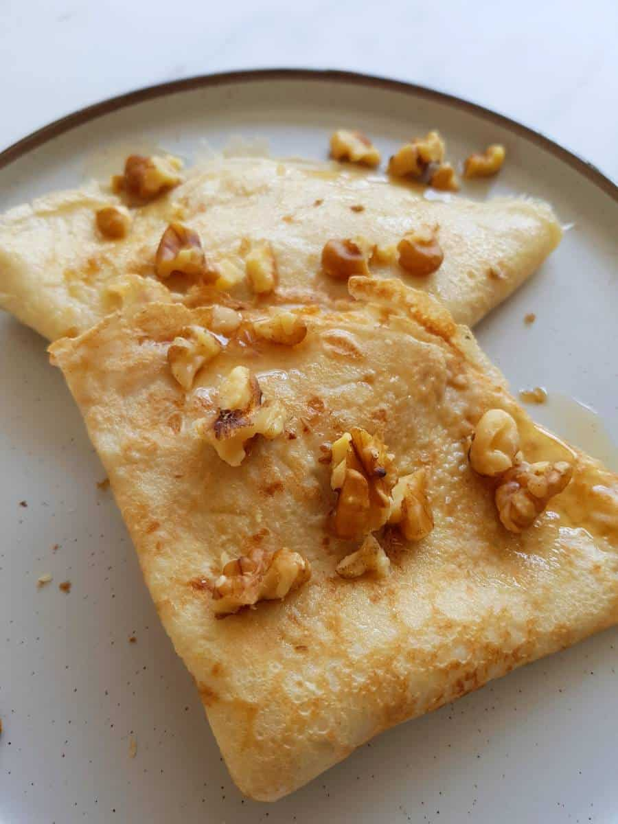 Crepes with almond milk on a plate.
