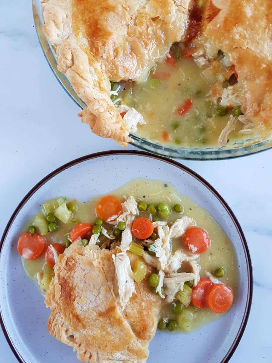 Dairy free chicken pot pie with a serving on a plate.