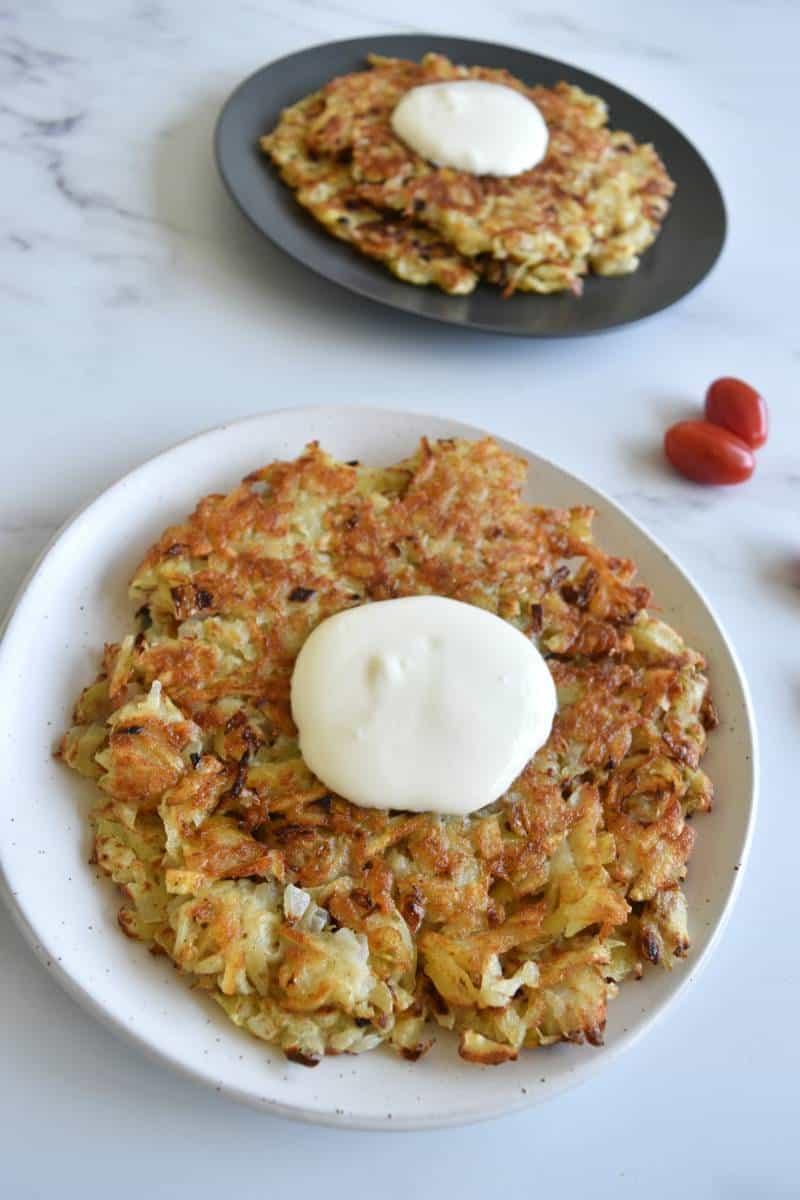 Draniki potato pancakes with sour cream.