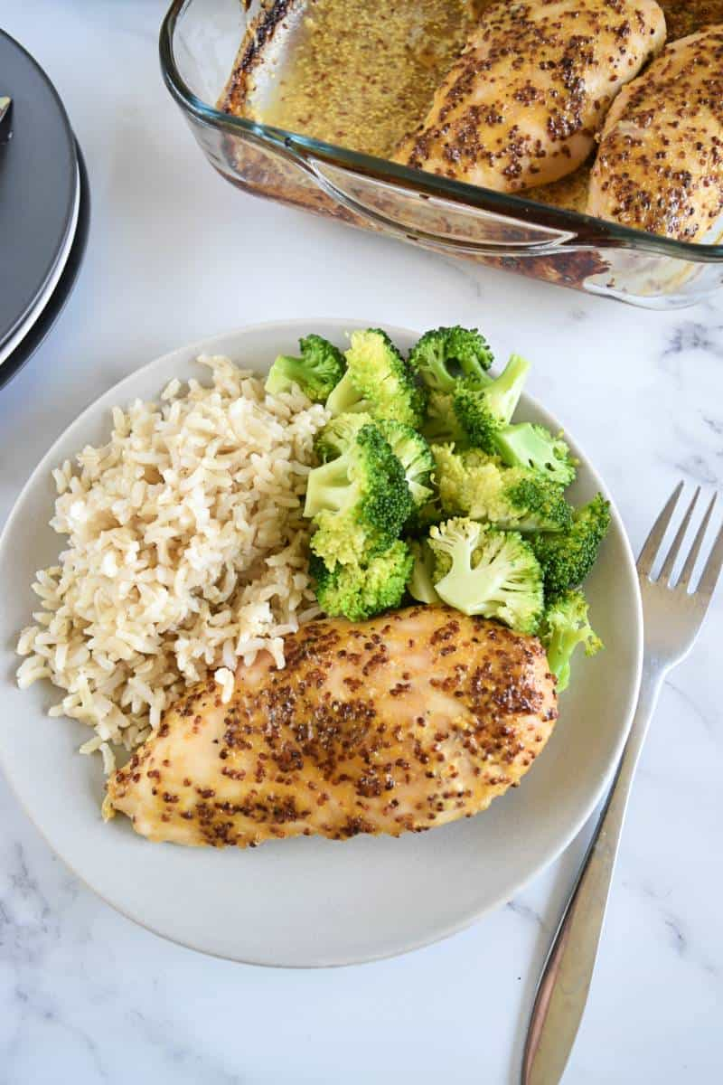 Honey mustard chicken with rice and broccoli on a plate.