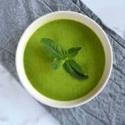 Pea soup with mint in a bowl.