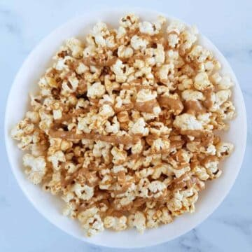 Peanut butter popcorn in a white bowl.