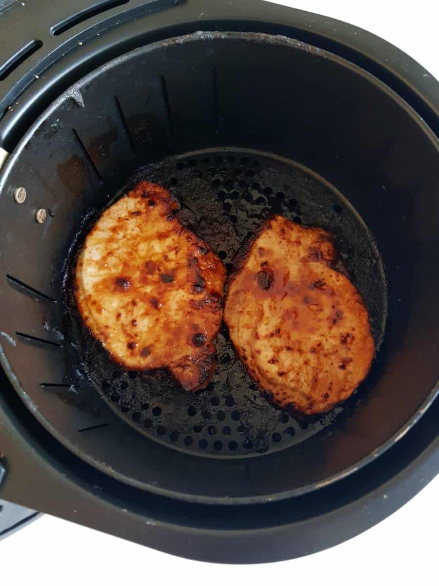 Pork chops in an air fryer.