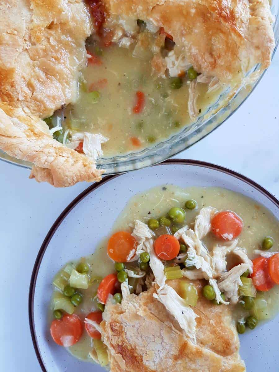Pot pie with chicken on a plate.