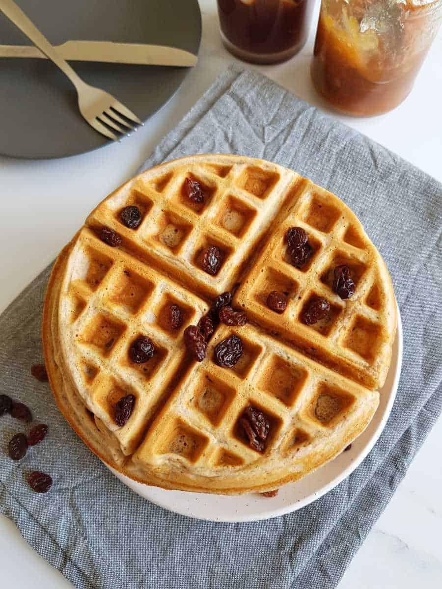Cinnamon raisin waffles on a plate.