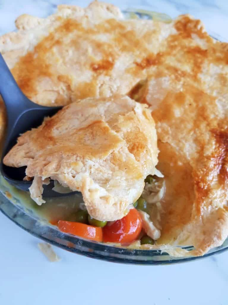 Serving dairy free chicken pot pie with puiff pastry.