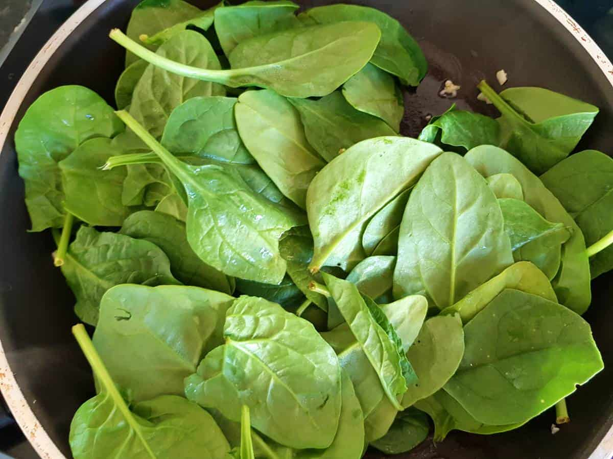 Spinach in a frying pan.