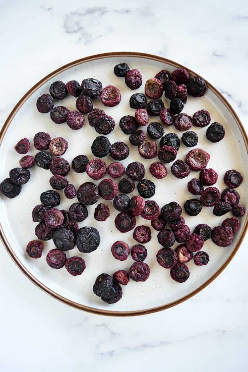Dried blueberries on a plate.